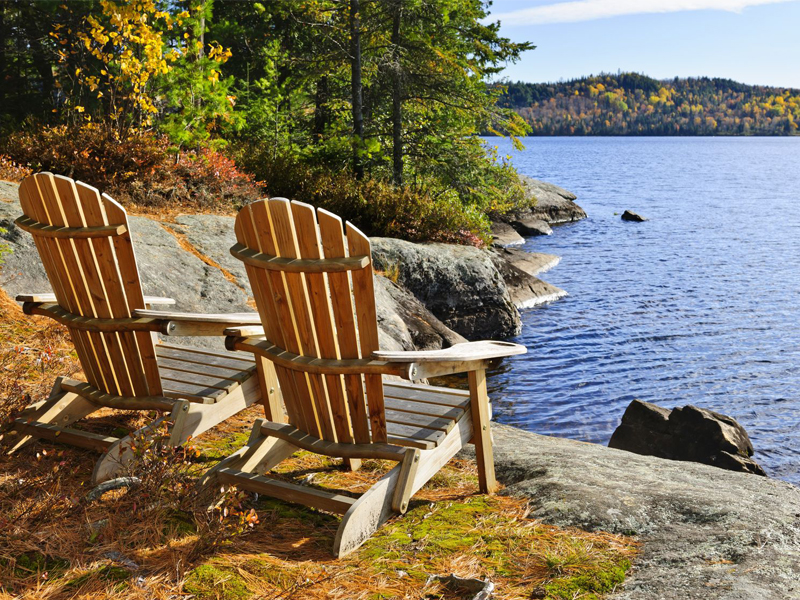Adirondack chairs at shore of Lake of Two Rivers, Ontario