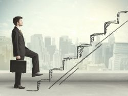 Business man climbing up on hand drawn staircase job change promotion corporate ladder