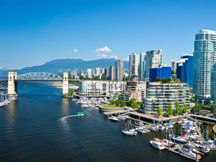 Downtown Vancouver, BC with bridge over harbour