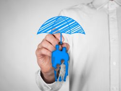 Family insurance policy concepts Insurance agent draw umbrella