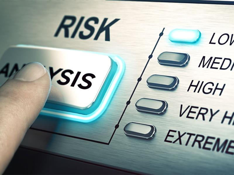 Finger on analysis button risk management or assessment concept
