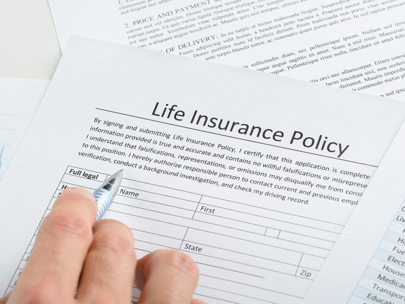Hand Filling Life Insurance Policy