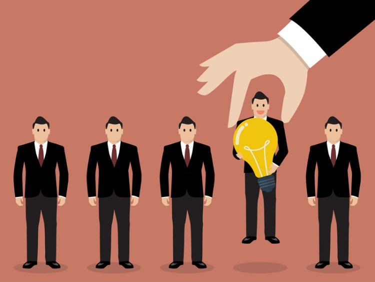 Hand choosing employee group of businessmen new job appointment notice
