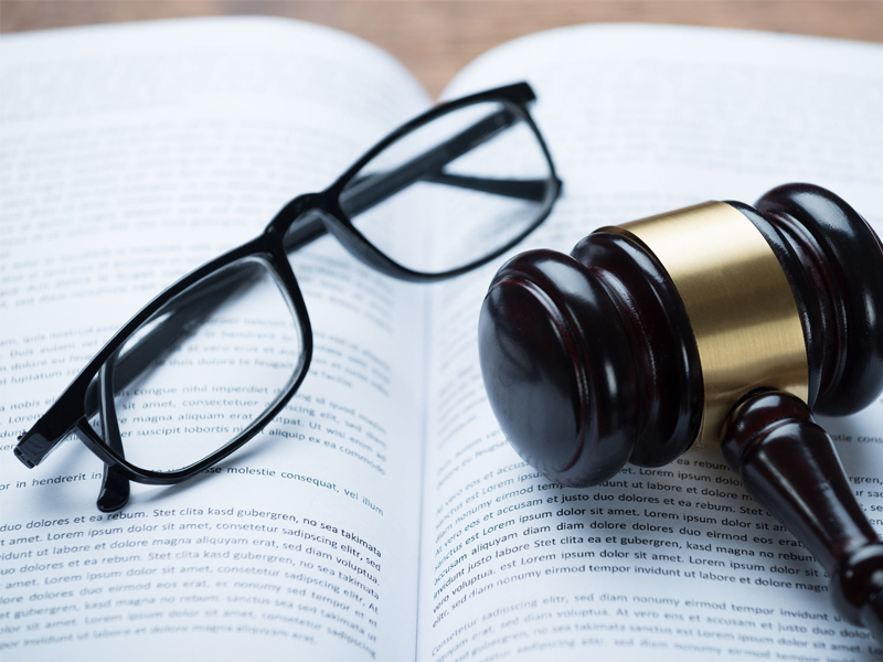High angle view of mallet eyeglasses legal book in courtroom