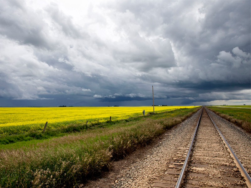 Storm Clouds over Saskatchewan field and tracks