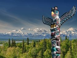 Totem pole with Mountains BC