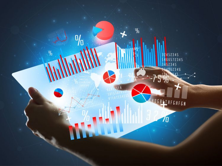 Young female hands tablet with red and blue charts analyze concept calculation