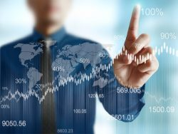 businessman with financial symbols charts and graphs