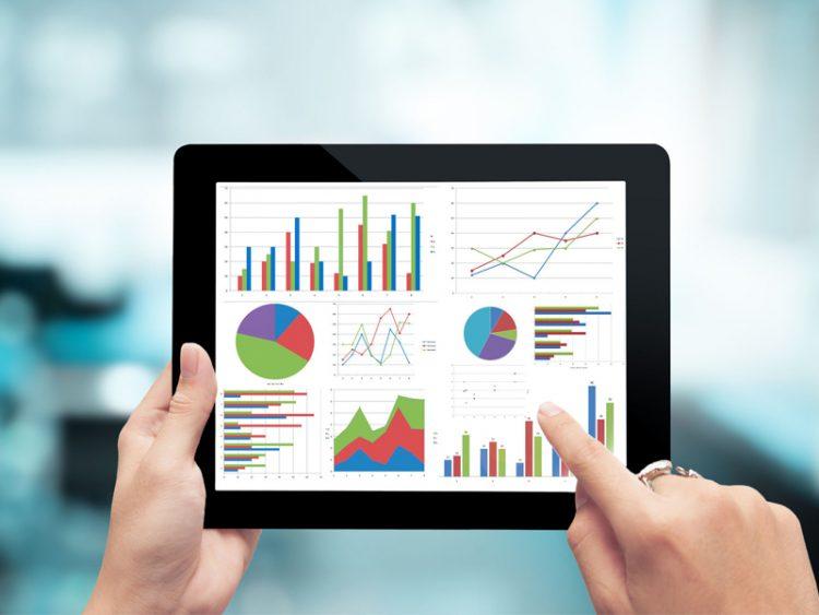 digital tablet hands graph planning economic business success