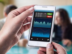 smart phone running a trading or forex app with charts and data