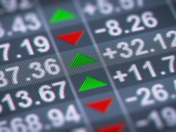 upclose stock market arrows green and red