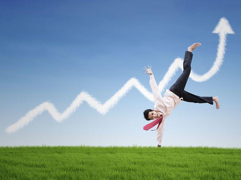 happy businessman dance on profit chart cloud under blue sky