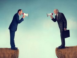 Two business men shouting through megaphones