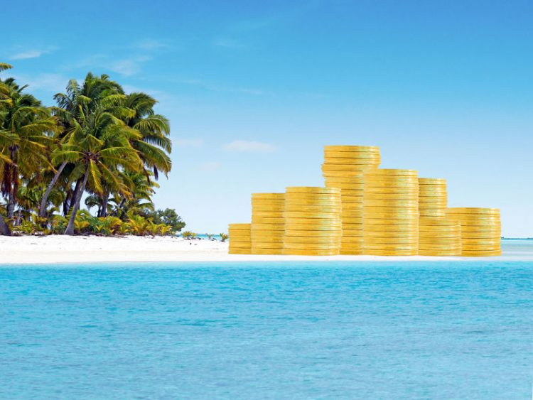 Gold coins on island with palm trees
