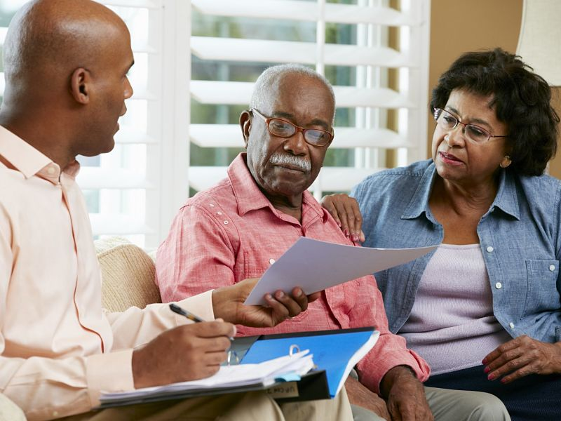 senior couple meets with advisor at home