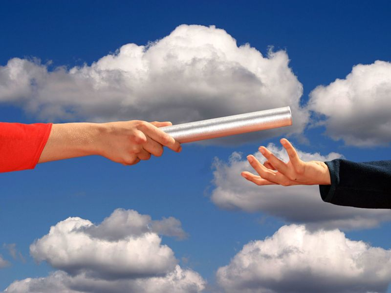 hands passing the baton, business succession theme