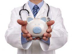 Doctor holding piggy bank