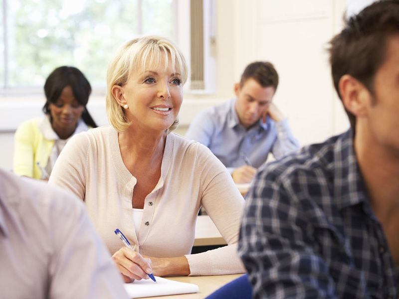 senior woman student in class