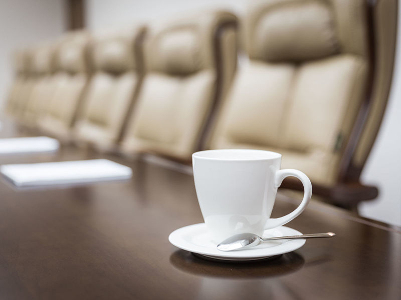 closeup of on table in empty corporate conference room