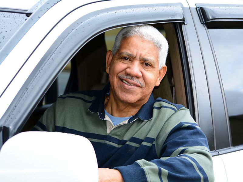 Senior man in driver's seat of car
