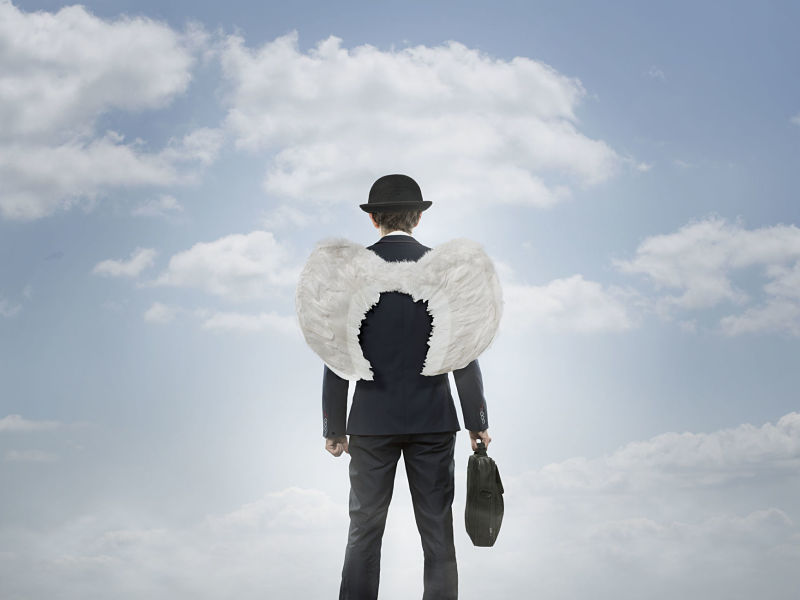 business angel against the sky