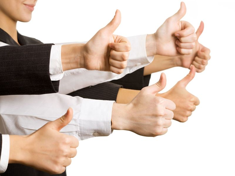 businesspeople hands showing thumbs up