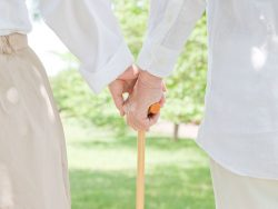 elderly couple who grips cane