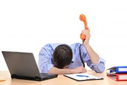 exhausted businessman holding a telephone