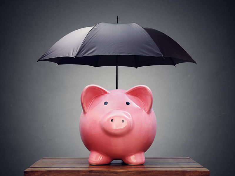 piggy bank with umbrella concept for finance insurance, protection