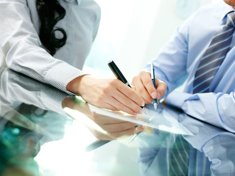 two business partners signing a contract