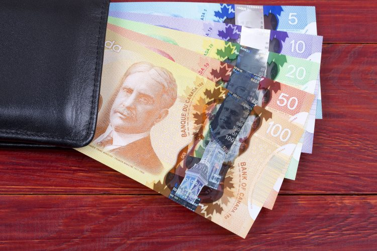 Canadian money in the black wallet