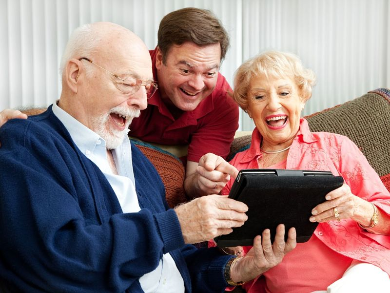 laughing family, senior parents and their adult son