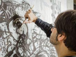 artist working in a original oil canvas
