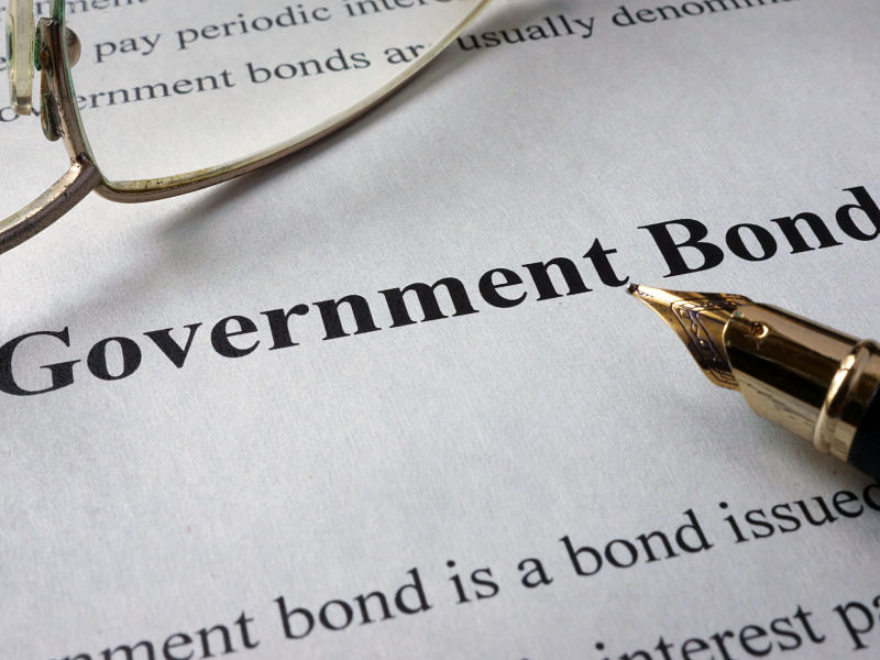 page of newspaper with words government bonds