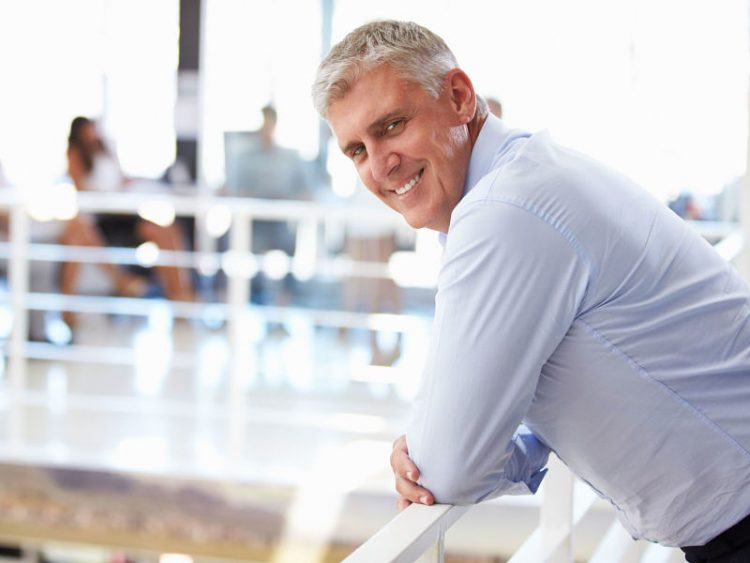 smiling middle aged man in office