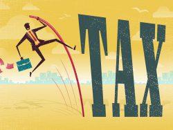 usinessman pole vaulting over a huge tax problem