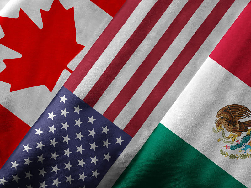 close up of the flags of Canada, the U.S. and Mexico