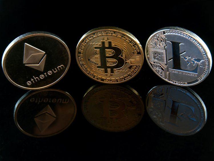 bitcoin ethereum litecoin concept coins on black