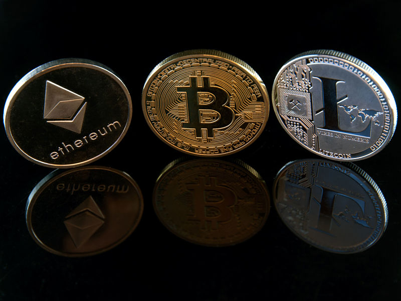 bitcoin ethereum litecoin concept coins on black