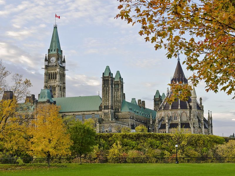 the canadian parliament and library during the fall