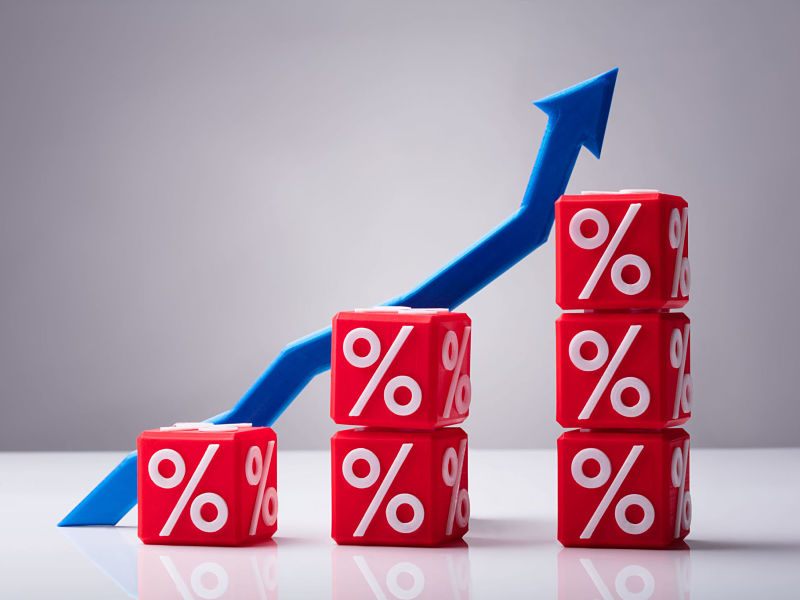 increasing stacked red cubes with percentage symbol and blue arrow showing upward direction