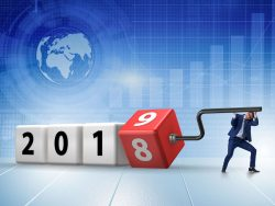 Businessman rotating cube to reveal number 2019