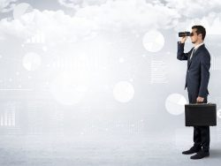 Businessman looking forward with binoculars cloudy background and graphs, charts around