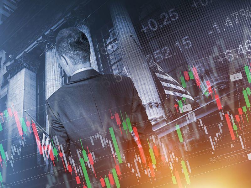 Man facing stock exchange, financial chart overlay