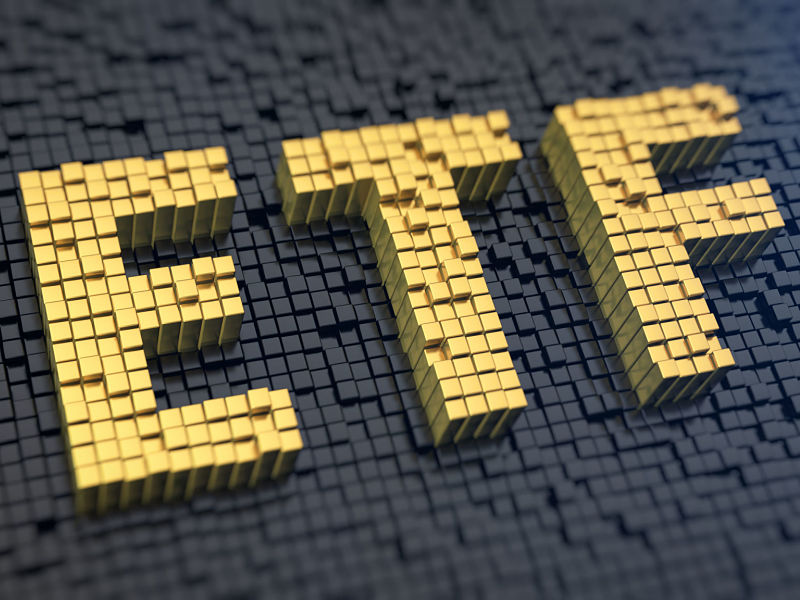33508688 - acronym 'etf' of the yellow square pixels on a black matrix background. stocks fund concept.