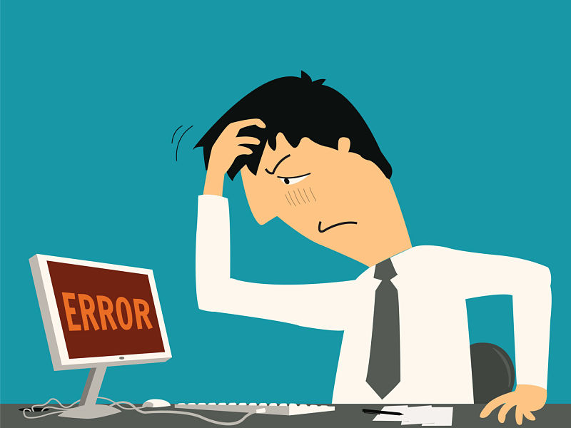 Businessman confused and being in bad temper with error message on computer.
