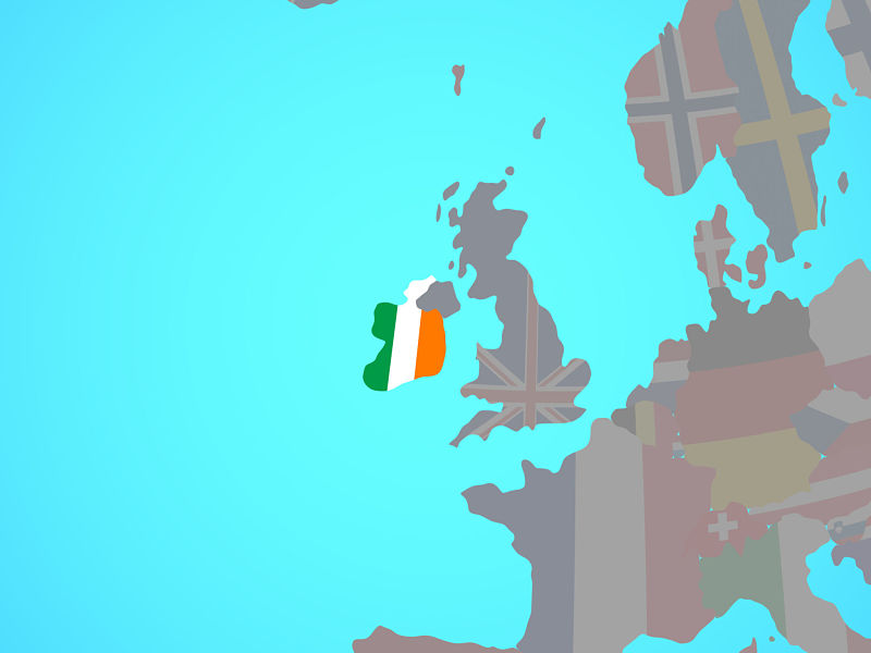 Ireland with national flag on blue political globe.