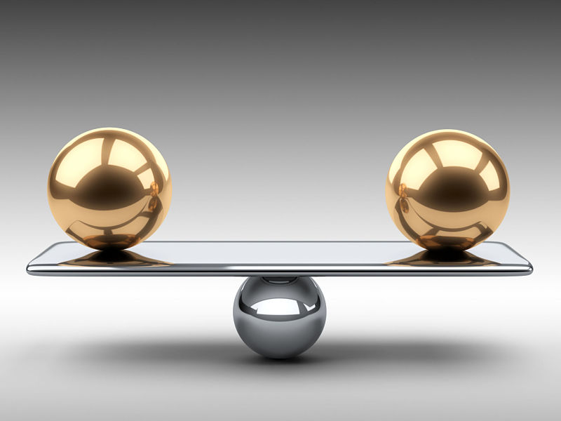 Balance between two large gold spheres. 3d illustration on a grey background.