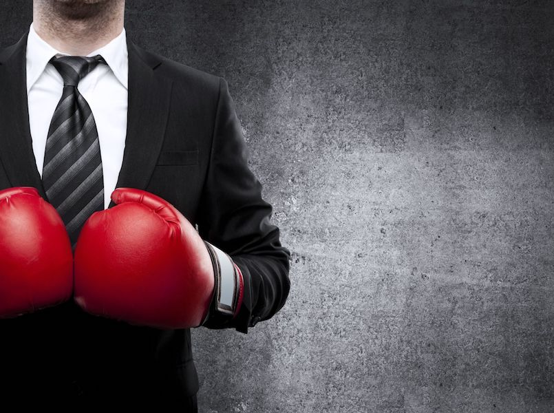 20280679 - businessman in boxing gloves on background