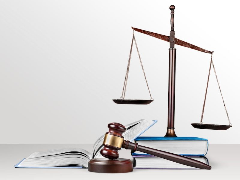 Justice scales and gavel by books